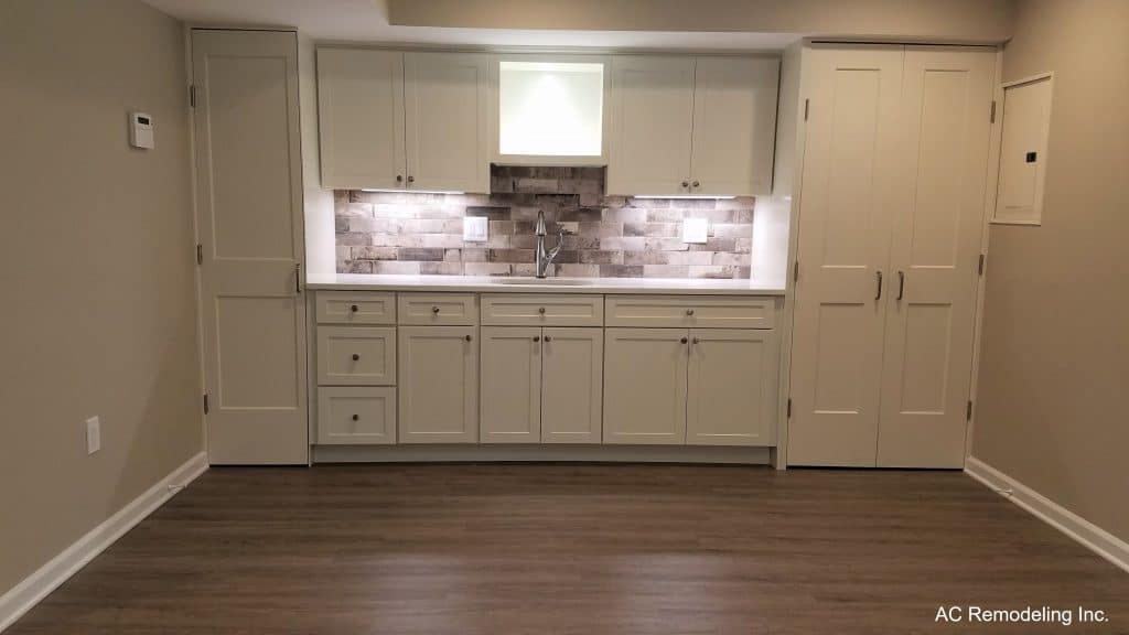 basement wet bar with white cabinets