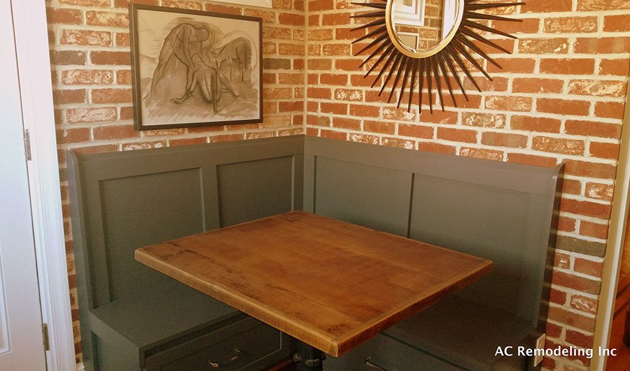 exposed brick in kitchen seating area