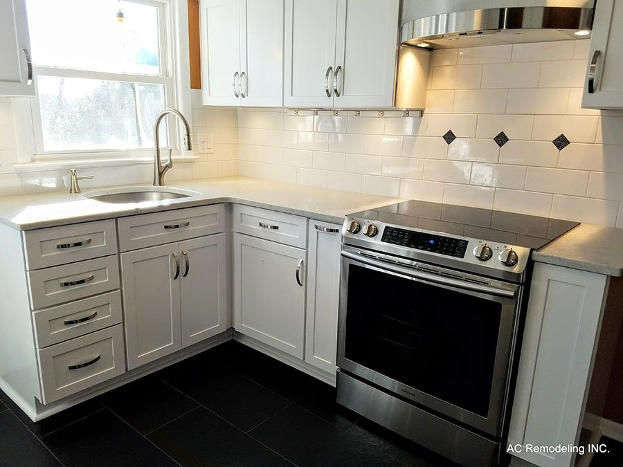 kitchen with while tile backsplash