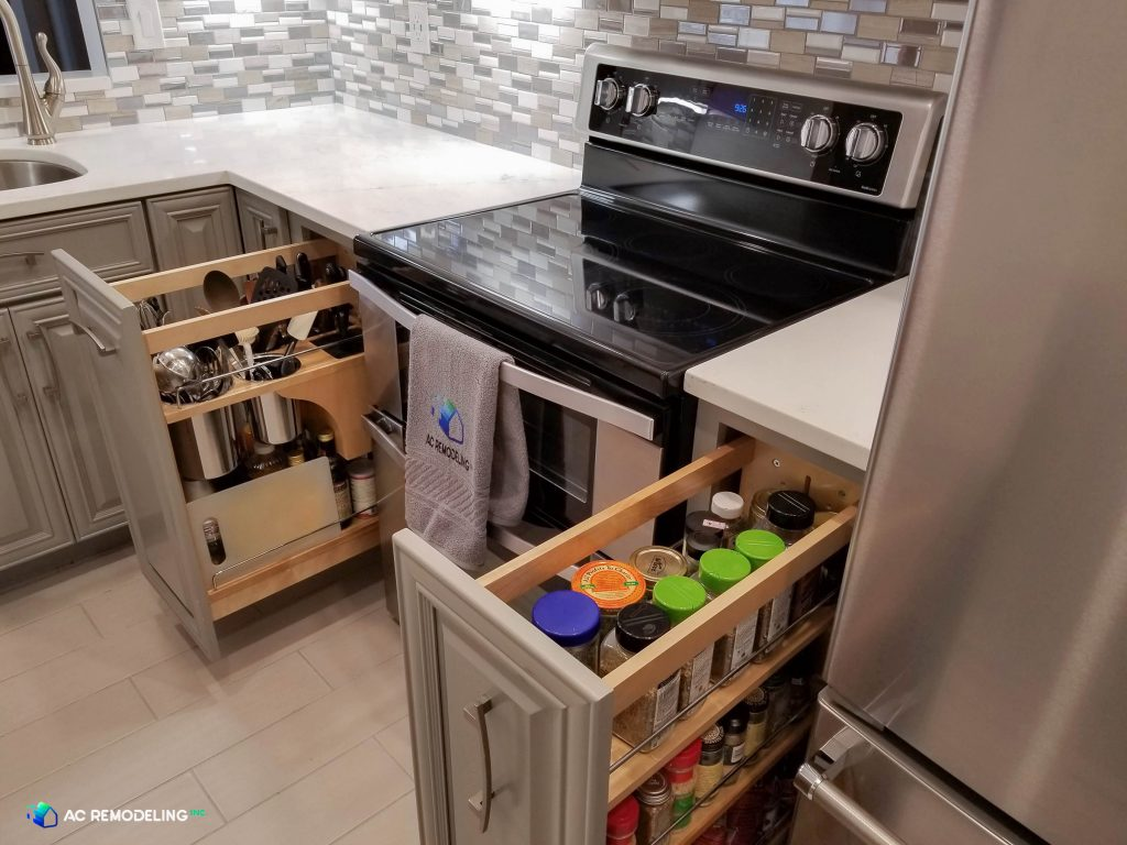custom kitchen with utensil and spice drawers