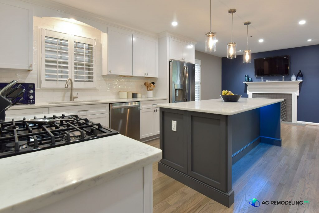 custom blue and white kitchen with a fruit bowl on the center island