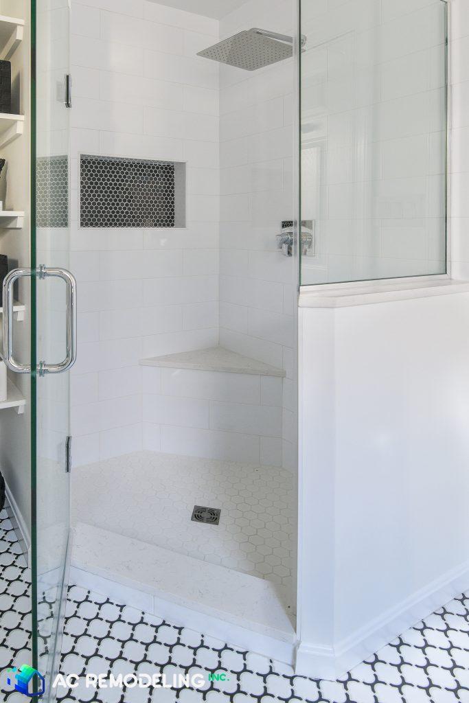 raised triangular tiled corner in a new shower